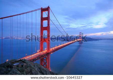 Golden Gate Bridge glows in the evening - stock photo