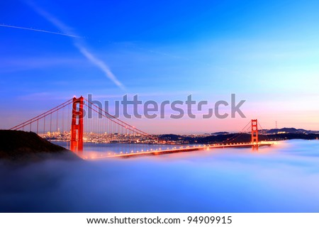 Golden gate bridge in fog - stock photo