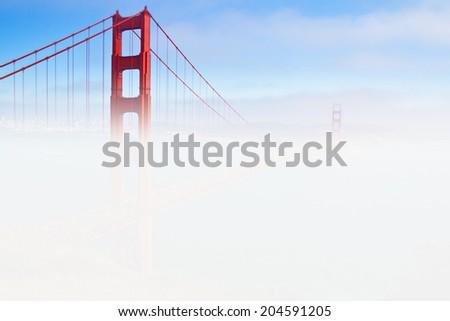 Golden Gate Bridge in fog, San Francisco, California, USA. - stock photo