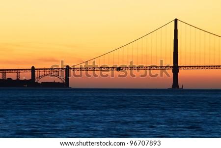 Golden Gate Bridge in San Francisco, California, USA at sunset from Treasure Island - stock photo