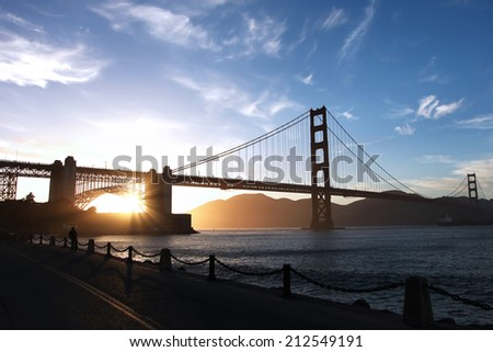 Golden Gate Bridge in San Francisco during a sunset - stock photo