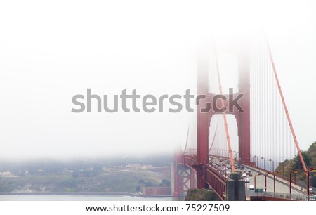 Golden Gate Bridge in San Francisco over the mist - stock photo