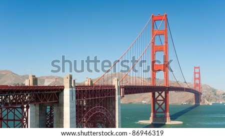 Golden Gate Bridge in San-Francisco; people unrecognizable; GPS information is in the file - stock photo