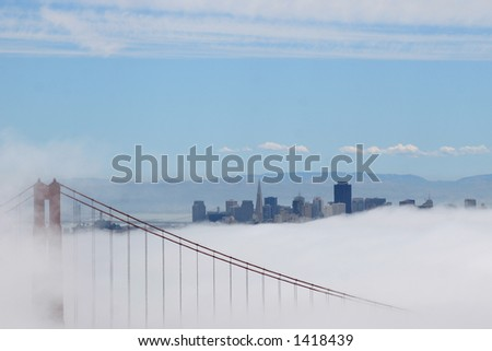 Golden Gate bridge in the fog. - stock photo