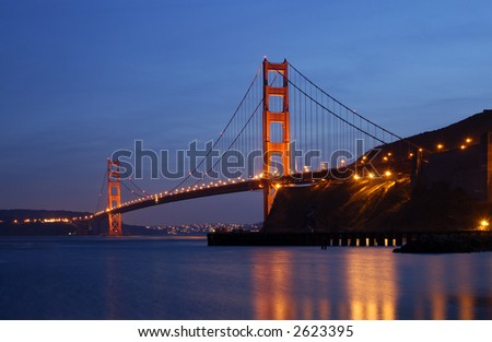 Golden Gate Bridge is glowing in the dusk - as seen from Fort Baker in Sausalito, California. - stock photo