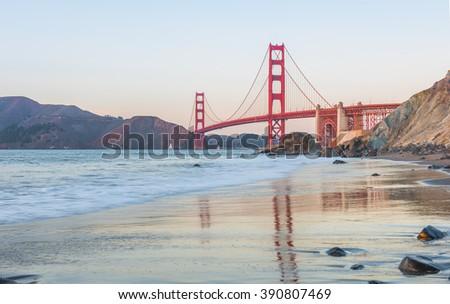 Golden Gate Bridge reflections in San Francisco at sunset  - stock photo