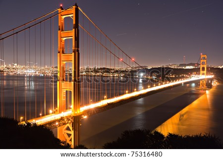 Golden Gate bridge San Francisco at dusk reflecting in the surrounding bay - stock photo