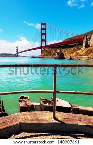 Golden Gate Bridge, San Francisco.  Viewed from a public fishing pier. - stock photo