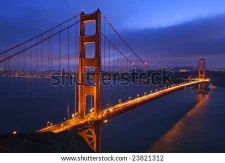 Golden Gate Bridge Sunset Pink Skies Evening with Lights of San Francisco California in background