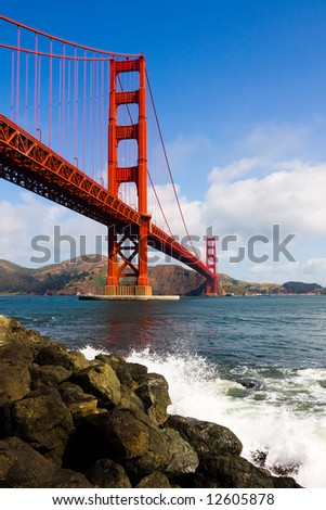 Golden Gate Bridge with cloudy sky - stock photo