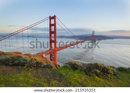 Golden Gate Bridge with green grass as foreground. San Francisco, USA.