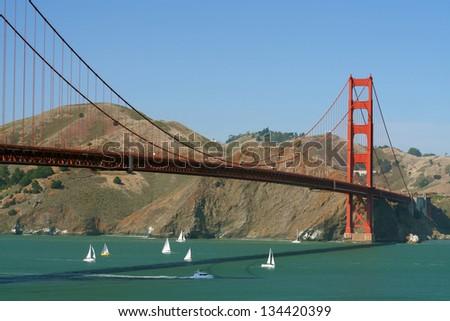 Golden Gate Bridge with mountain range in the background, San Francisco Bay, San Francisco, California, USA - stock photo