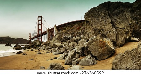 Golden Gate Bridge with rock panorama in San Francisco as the famous landmark. - stock photo