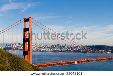 Golden Gate Bridge with San Francisco skyline in the background - stock photo