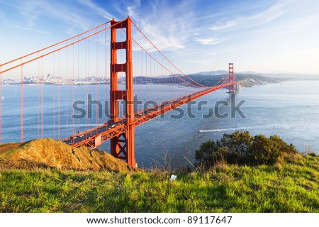 Golden Gate in clear blue sky with green grass as foreground. San Francisco, USA. - stock photo
