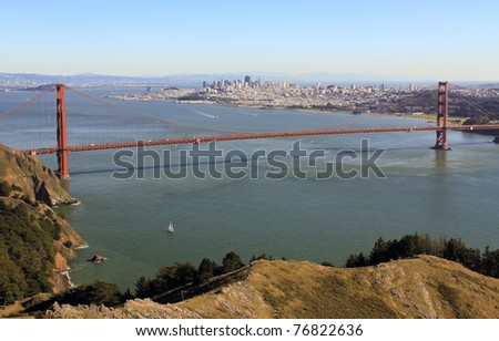 GOLDEN GATE NATIONAL RECREATION AREA, CALIFORNIA: Golden Gate Bridge taken from Hawk Hill overlook in Marin County near Sausalito with sailboat in foreground. - stock photo