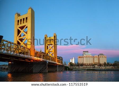 Golden Gates drawbridge in Sacramento in the night time - stock photo