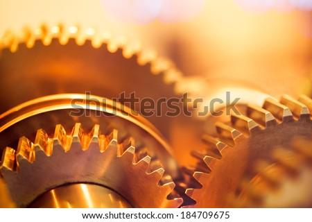 golden gear wheels, close-up - stock photo