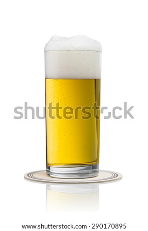 golden german beer in a glass with beermat on white background