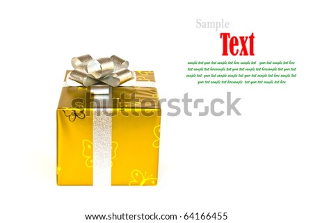 Golden gift box decorated with silver ribbon isolated on white background. - stock photo