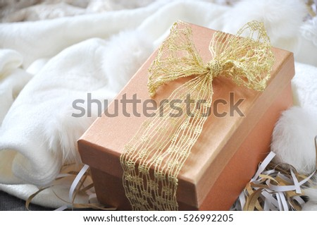Golden gift box put on white scarf background