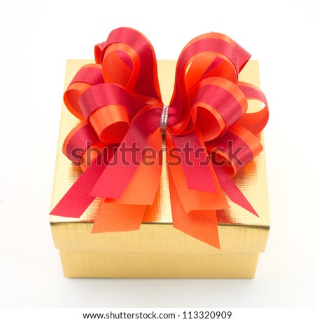 Golden gift box with red bow isolated on white background - stock photo