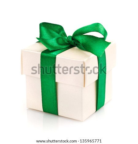 golden gift box with silver ribbon and bow isolated on white - stock photo