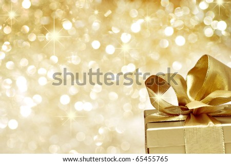 Golden gift on defocused lights background