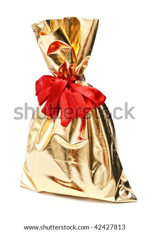 Golden gift sack on white background - stock photo