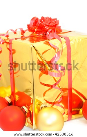 Golden gift with shiny Christmas balls