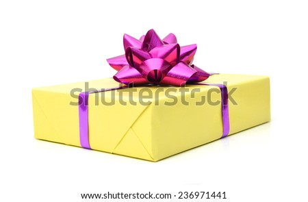 Golden gift wrapped present with pink ribbon bow isolated on white - stock photo