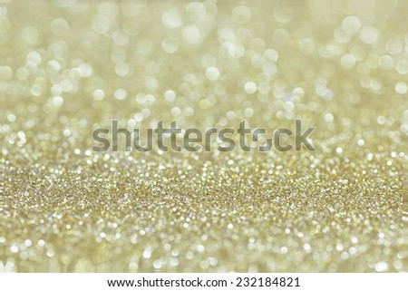 Golden Glitter for Christmas Background with Blurred Lights. - stock photo