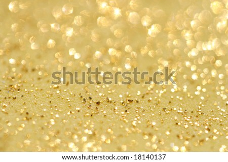 golden glitter sparkles dust  background - stock photo