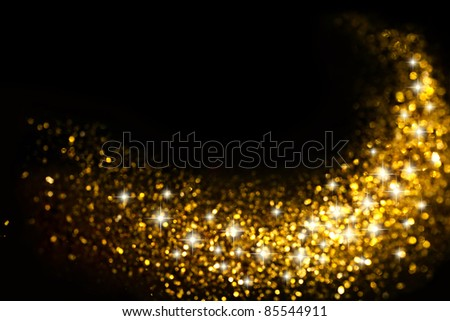 Golden Glitter Trail with Stars Background with space for your text - stock photo