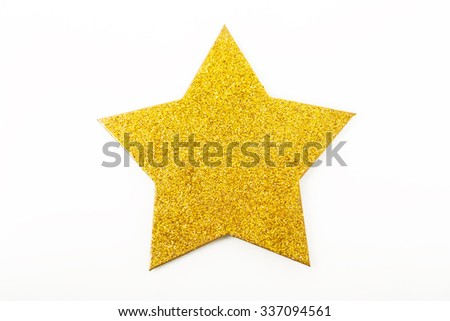 Golden glittering star shaped Christmas ornament isolated on white background  - stock photo