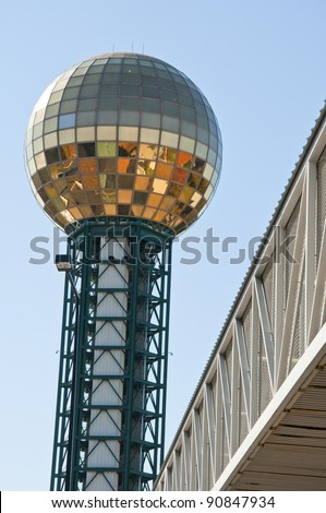 Golden globe structure in city - stock photo