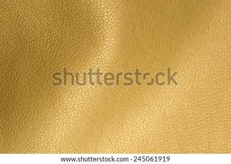 Golden Glossy Artificial Leather Background  - stock photo