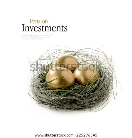Golden goose eggs placed in a authentic looking grass nest against a white background. Concept image for pension savings. Copy space. - stock photo