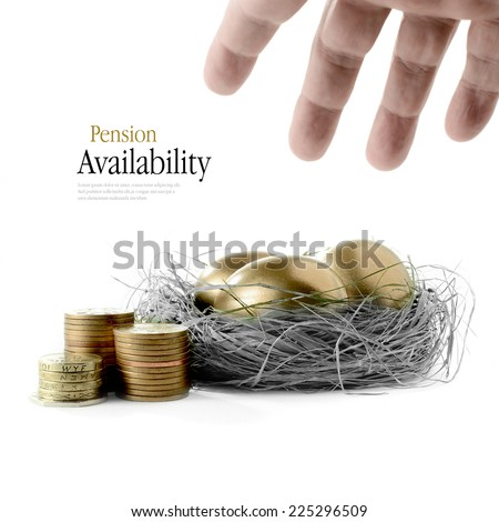Golden goose eggs placed in a authentic looking grass nest against a white background with hand reaching. Concept image for pension savings and investments availability. Copy space. - stock photo