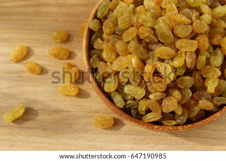 Golden grapes on a plate with an ideal background