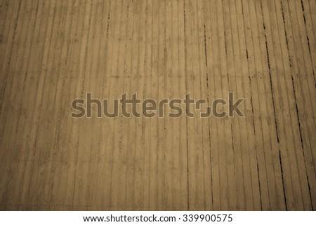Golden Grunge Backdrop.  Dark golden-yellow cement exterior wall for use as an advertising backdrop. - stock photo
