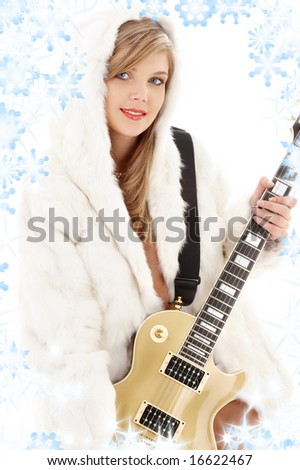 golden guitar girl in fur with snowflakes - stock photo