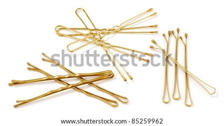 golden hairpins isolated on white - stock photo