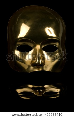 Golden half-face mask isolated on black background