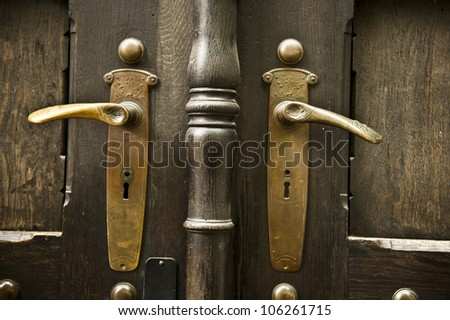 Golden handles on a brown building.