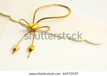 Golden heart close-up, Envelope and mail wedding invitations - stock photo