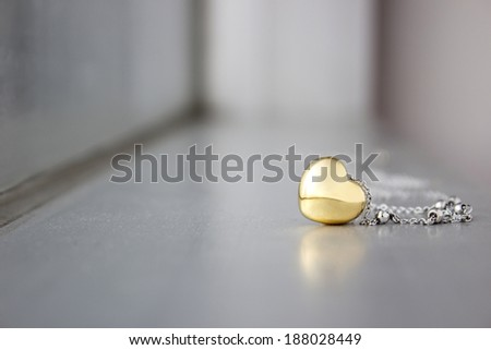 Golden heart shape connect with chain use for abstract of love sign. - stock photo