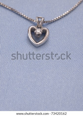 golden heart with diamond - stock photo