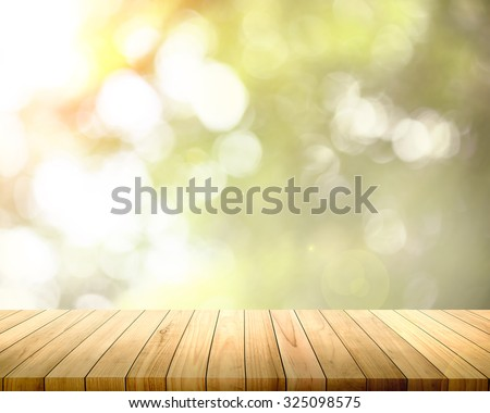 Golden heaven light Hope concept abstract blurred background with uniform wood pave in front from nature for background design and decoration - stock photo