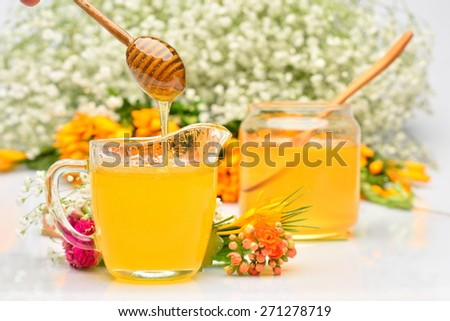 golden honey and colorful flowers